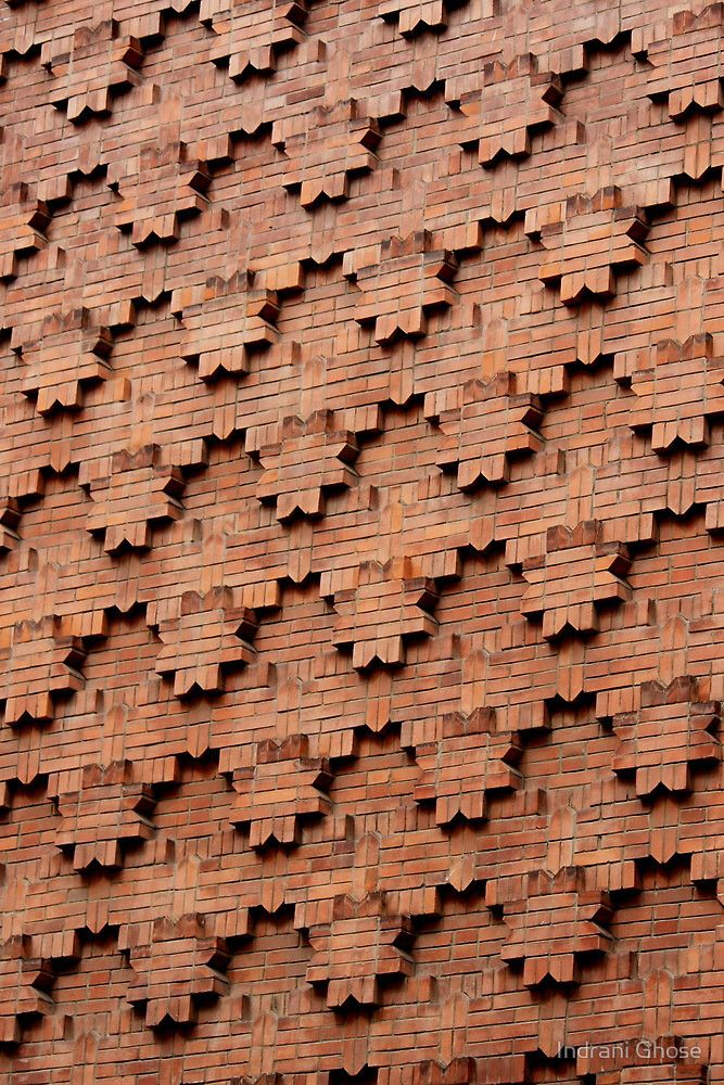"""The credits list this as a wall  in """"Turin, Italy."""" Don't know if this is traditional brickwork, or something particular to this building and the era it comes from, I'm gonna go with the latter. Photo: Indrani Ghose."""