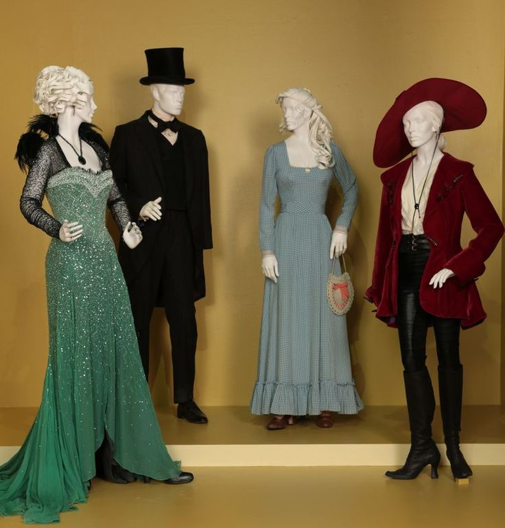 """Oz the Great and Powerful"" costumes by Gary Jones. (L to R) Rachel Weisz as Evanora, James Franco as Oz, Michelle Williams as Annie/Glinda, Mila Kunis as Theodora. Via FIDM Museum."