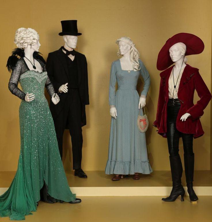 """Oz the Great and Powerful"" costumes by Gary Jones. (L to R) Rachel Weisz as Evanora, James Franco as Oz, Michelle Williams as Annie/Glinda, Mila Kunis as Theodora. Via FIDM Museum."