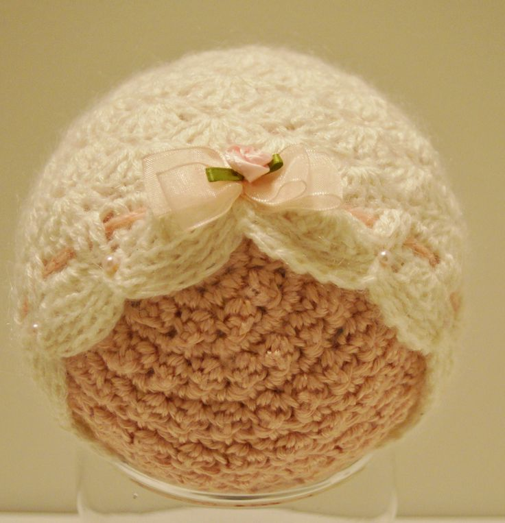 Baby girl photo prop hat. Made with super kid mohair, featuring delicate stitches and deeply scalloped edges. Embellished with pink faux pearls and ribbon.