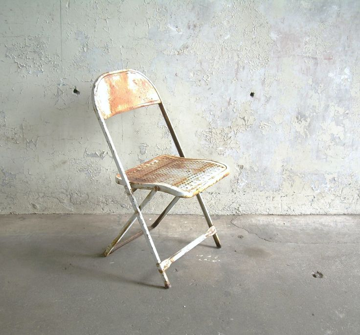 Image result for rusty folding chair