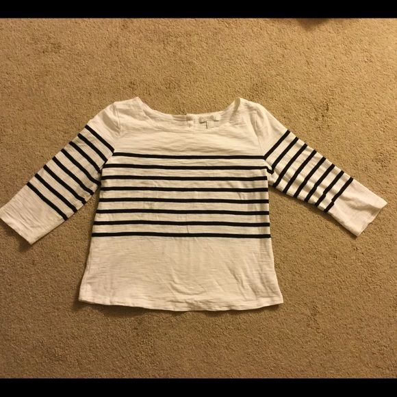 Forever 21 black and white shirt Black and white striped shirt from Forever 21. Sleeves are 3/4 length. 3 gold buttons on the back. Excellent condition. Forever 21 Tops
