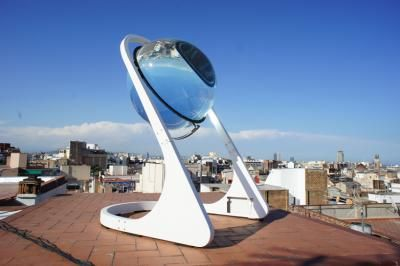 German architect André Broessel, of Rawlemon created a spherical sun-tracking solar energy-generating globe -- essentially a giant glass marble on a robotic steel frame. It concentrates both sunlight  moonlight up to 10,000 times -- making its solar harvesting capabilities 35% more efficient than conventional dual-axis photovoltaic designs.