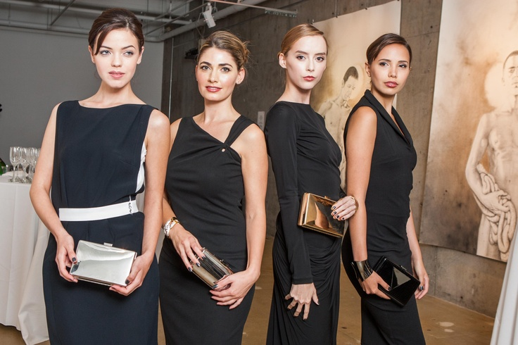 From left to right:  Sara holds the Art Deco clutch, Ellian Raffoul holds the 450 Sutter, Hanna holds the Art Deco, and Barbara holds the Holland Park.