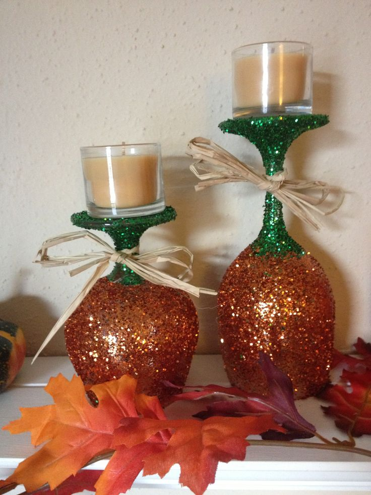 Glittered pumpkin wine glass and snifter! Using old stemware, glitter, glue and a clear spray to finish. Great candle holders. Cheap and easy.
