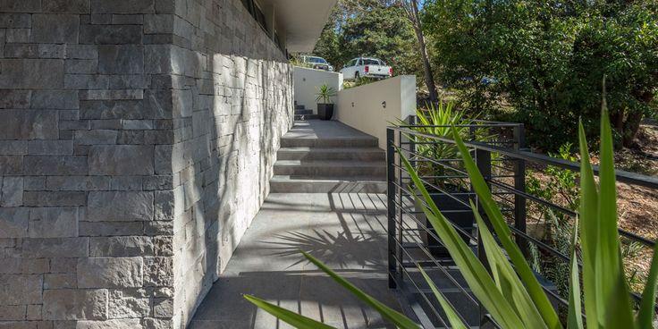 Cabana Wall Cladding #naturalstonewallcludding #waterfronthome #fireplace #facade #retainingwall #featurewalls #wallcladding #architecturaldesign