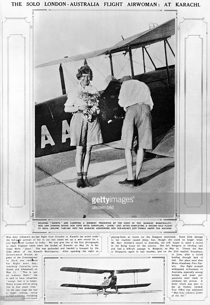 Fliegerin, GBnach der Ankunft in Karachi (Brit.-Indien)auf ihrem Alleinflug von London nach Darwin (Australien):- steht in Shorts vor ihrem Gipsy Moth - Doppeldecker 'Jason'.aus: Illustr. London News, Mai 1930