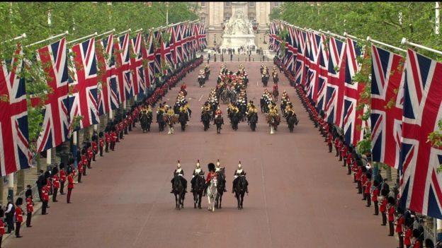 The Queen travelled down the Mall from Buckingham Palace accompanied by the sovereign's escort of Household Cavalry.