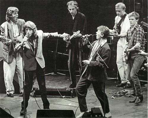 Paul McCartney, Mick Jagger, David Bowie, Mark Knopfler, Mark King, and Bryan Adams performing in London, 1986