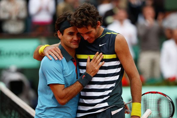 Juan Martin Del Potro Photos Photos - Roger Federer (L) of Switzerland  is congratulated by Juan Martin Del Potro of Argentina following his victory during the Men's Singles Semi Final matchon day thirteen of the French Open at Roland Garros on June 5, 2009 in Paris, France.  (Photo by Clive Brunskill/Getty Images) * Local Caption * Roger Federer;Juan Martin Del Potro - 2009 French Open - Day Thirteen