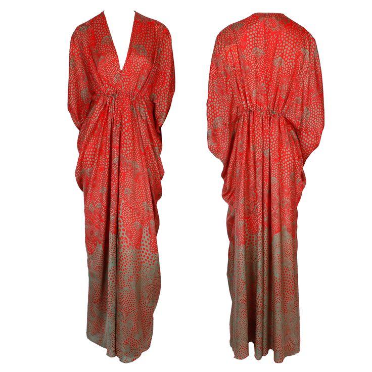A floor-length red and brown printed Kaftan dress with a V-neckline and draping bodice by Issa London #issa #dress #print #kaftan #ramadan #draping #fashion #greenbird #trend #luxury #hautecouture #gbmoda #dubaifashion #abudhabi #marinamall #elegance