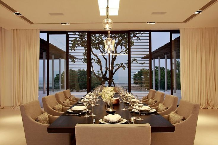 I like these dining chairs.  Luxurious Phuket Villa - contemporary dining room furniture design - Decoist