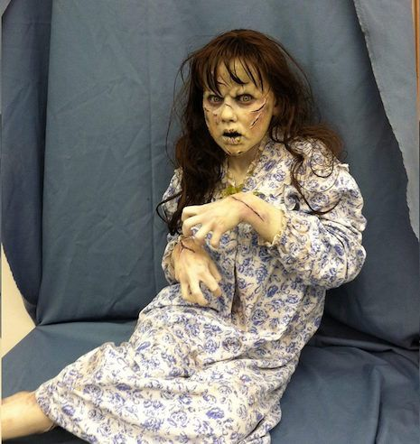 Life-sized sculpture of Regan MacNeil (played by Linda Blair) from The Exorcist (1973)