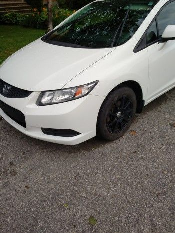 2013 Honda Civic EX Coupe with sunroof, 16 inch enkei mags and auto-starter all…