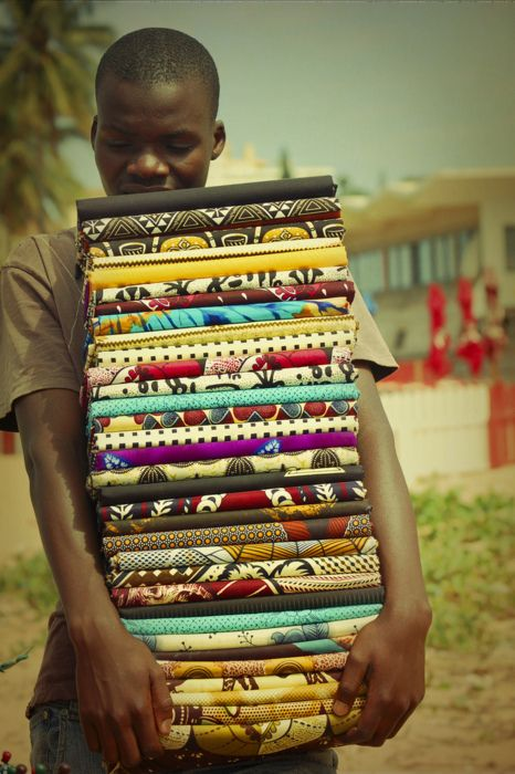 Africa |  Sights and Sounds.  Textile Vendor in Maputo, Mozambique    Photo by Paty Jimenez