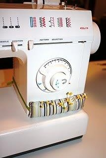 """Love this little tube pincushion attached to the sewing machine idea! Super easy to make (measure the area, cut fabric 1/4"""" larger than what you measured, sew and stuff. Attach it with velcro tape. ♥  By: Mark Lipinski's Fan Page!   http://icanfindthetime.blogspot.com/2010/07/sewing-machine-pin-cushion.html  Sewing Machine Pin Cushion  icanfindthetime.blogspot.com"""