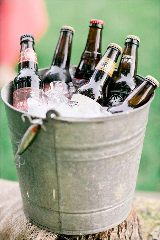 bucket filled with beer http://www.weddingchicks.com/2013/10/17/our-favorite-drink-stations/