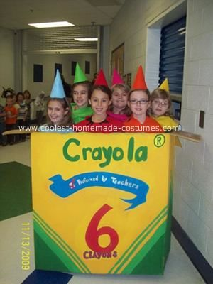 Crayola Crayons and their Box Costume: We made the girls these homemade crayola crayons and their box costume with felt, black paint metal clothes hangers, and party hats.  The box we painted