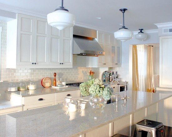 River White Granite Countertops  white glass titled walls with white grout... This is pretty too.
