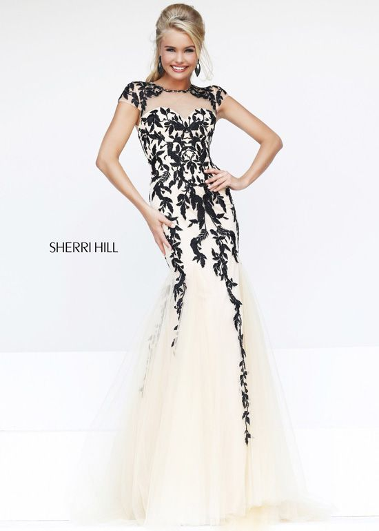 Sherri Hill 1927 - Nude/Black Illusion Short Sleeve Prom Dresses Online. This stunning evening gown features a sheer top over sweetheart bodice with embroidered embellishments on a form-fitting bodice, jewel neckline and short sleeves.