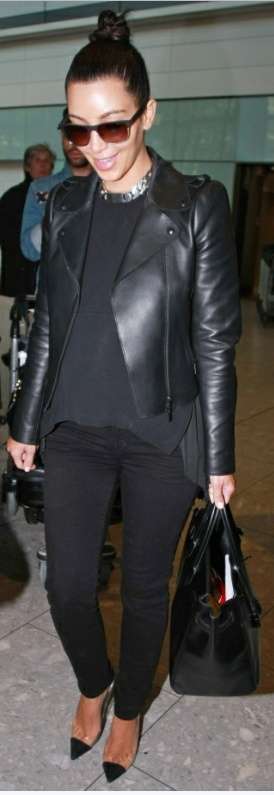 Kim Kardashian in J Brand jeans, Celine top, Valentino jacket, Tom Ford sunglasses and Christian Louboutin shoes.