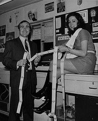 4th Dec 1970: Chelsea captain Ron Harris helps Jackie, a Chelsea fan, become the first person to receive a football ticket from the automati...