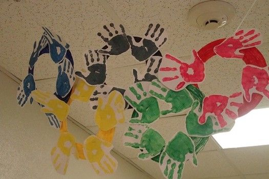 Olympic rings made out of painted handprints