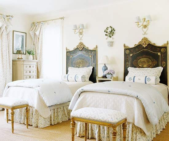 An antique daybed converted into two twin headboards. Stools.  Via Better Homes  Gardens.