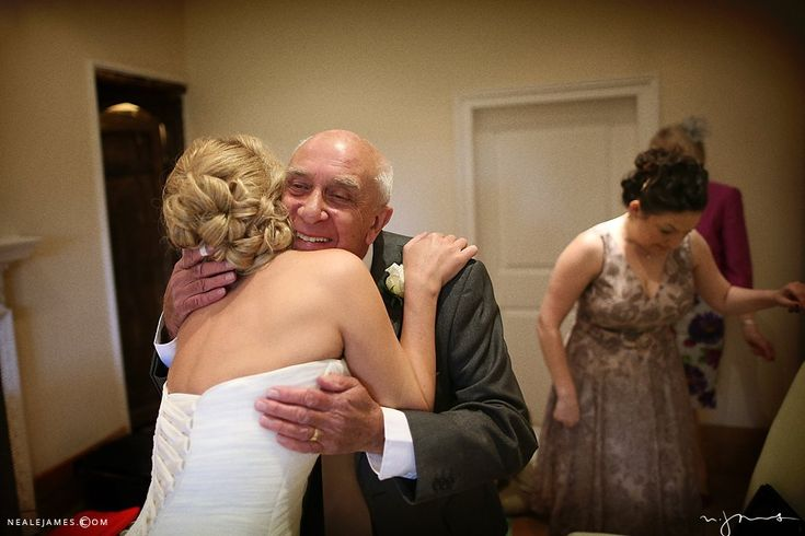 The moment a father sees his daughter, the bride, in her wedding dress for the first time via nealejames.com