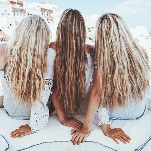 Three very bronzed and blonde babes.