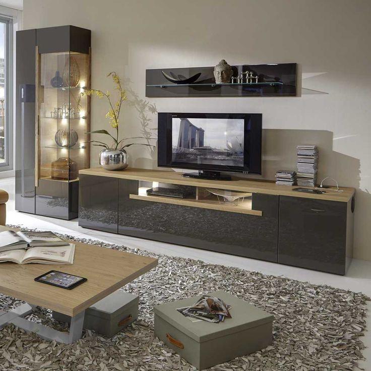 schrankwand in braun hochglanz eiche das besondere der wohnwand ist das lowboard. Black Bedroom Furniture Sets. Home Design Ideas