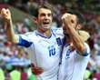 JUNE 16:  Giorgos Karagounis and Giorgos Tzavelas of Greece celebrate victory and progress to the quarter finals during the UEFA EURO 2012 group A match between Greece and Russia at The National Stadium on June 16, 2012 in