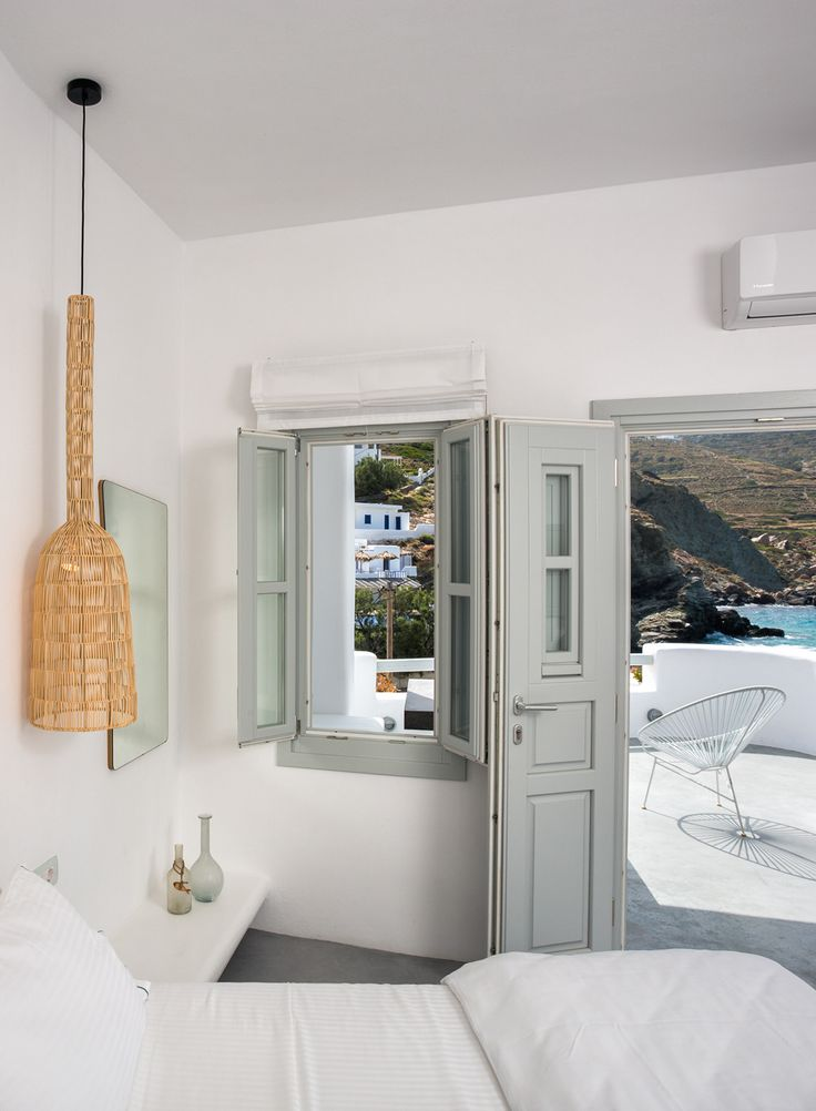 Blue Sand Boutique Hotel, Folegandros, Greece – book through i-escape.com || A gorgeous beachside hotel where lazy days are spent flopping beachside on the terrace's comfy bean bags, then sampling Greek salad and stuffed vine leaves at local tavernas before watching the sun set from your balcony.