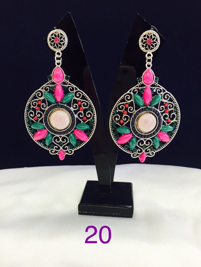 Long looped earring with circular design. Various colours and designs available.