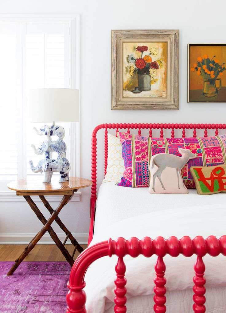 Colorful Bedroom with Hot Pink Bed and Purple Antique Rug