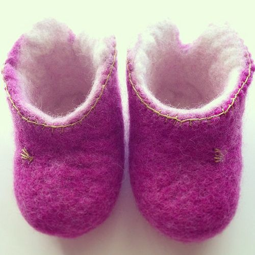 Pink-white baby booties.