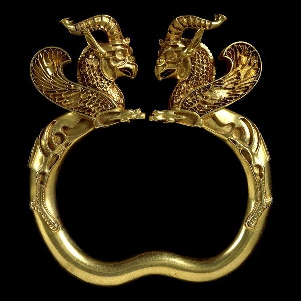 """An outstanding gold griffin-headed armlet from the Oxus treasure, Achaemenid Persian, 5th-4th c BC. This object would originally definitely have featured stones which since have been lost. It is however greatly admired as a jewel even so, and in our view rightly. A gold griffin-headed armlet from the Oxus treasure, Achaemenid Persian, 5th-4th c BC. One of many great pieces making up Hamed Behroozkar's album """"Masterpieces of Ancient Iranian Art"""".  73670_457019038048_825536_n.jpg (600×600)"""