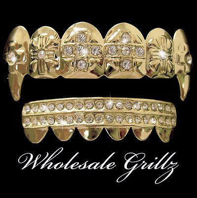REAL 14K GOLD PLATED iced out Grill VAMPIRE Dracula Fang HIPHOP Teeth ICE GRILLZ gold plated teeth buy now from ebay seller wholesalegrillz and follow us at wholesale grillz only $24.95!!