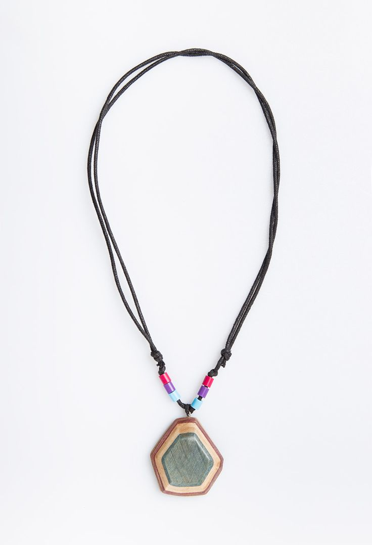 Green Pentagon Mejiku Necklace by Kabau. The series of mejiku necklace that mostly has variety of colors at the necklace. Handcrafted with care and made by passion from mapplewood as material in green color from reused skateboard. Unique design with touch of pink, purple and blue beads also with adjustable stripes black strings.  http://www.zocko.com/z/JJymB