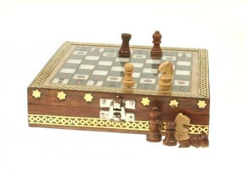 Wooden hinged chess box with brass detailing around sides and edges, brass latch and baize base and inner lining. The board on top is painted using a technique known as gem stone painting, the colour is made up of crushed semi-precious stones making it fade resistant and giving a beautiful shimmering finish. Includes full set of carved wooden chess pieces. £16.99 from Holly House Gifts at the Enterprise Shopping Centre, http://www.enterprise-centre.org/shop/holly-house-gifts