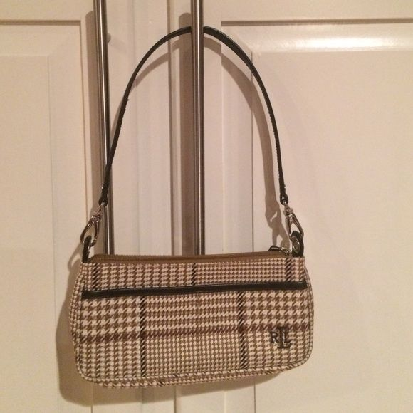 """Ralph Lauren Handbag Small Clutch Tan Cute mini purse / clutch . No signs of wear for this clean excellent condition Ralph purse. Houndstooth, plaid or herringbone pattern. Browns, tans. Inside 2 pouches plus security zippered pocket. Outside pouches. Zip closure. Take the leather strap off and use as a clutch. Classic RL. Preppy. Traditional or transitional. Guaranteed authentic from very clean smoke free home. Measuring. 9"""" long x 4"""" tall and 12"""" with strap.  ( see scale with glove in…"""