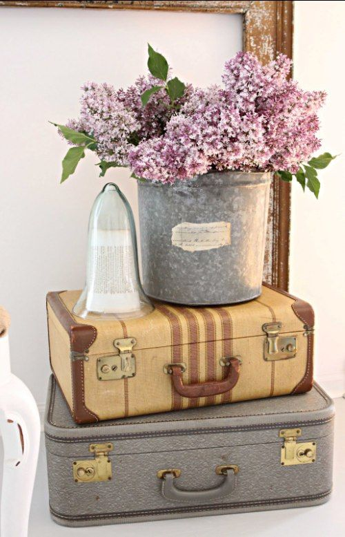 lilacs in galvanized bucket with vintage suitcases- love! #flowers #purple #lavender