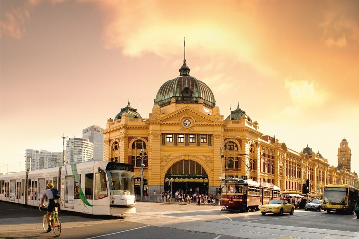 Flinders Street station in the beautiful city of Melbourne with trams!!