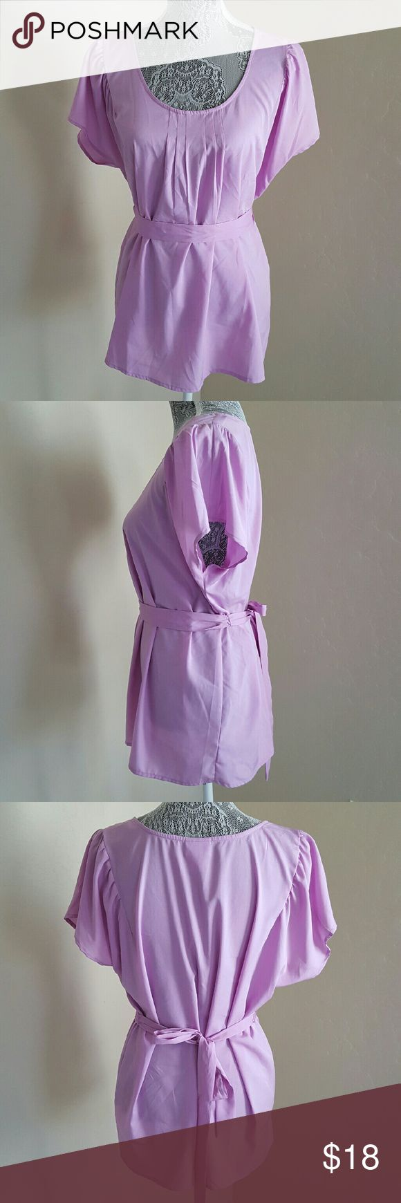 Flutter Sleeves Maternity Blouse This maternity blouse features flutter sleeves, scoop neckline, and tie back for bump adjustability. Pre-loved and in excellent condition. 100% polyester, machine washable. Color is lilac. Motherhood Maternity Tops Tees - Short Sleeve