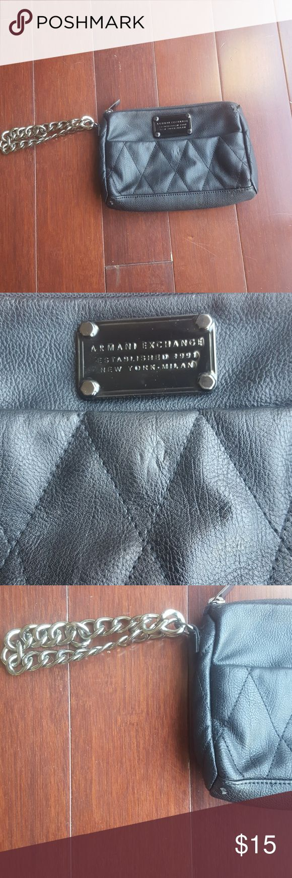 Armani Exchange wristlet Black wristlet with gun metal look chain. the corners of the bag are peeling, it is not leather. Easy to wear amd can be dressed up or down. Armani Exchange Bags Clutches & Wristlets