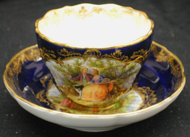 Meissen cup and saucer with royal scenes. Circa 1800's