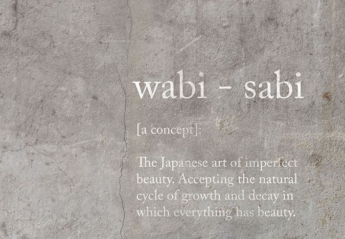 Description of the Wabi Sabi philosophy written on concrete
