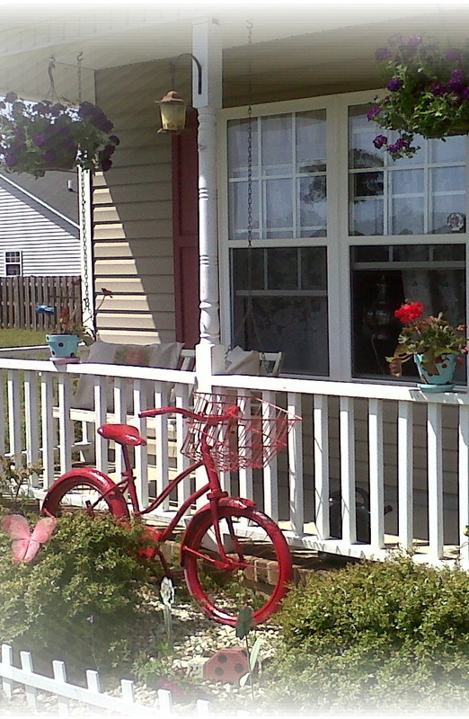Old farm house front porch with painted vintage bike decor for Classic house fronts