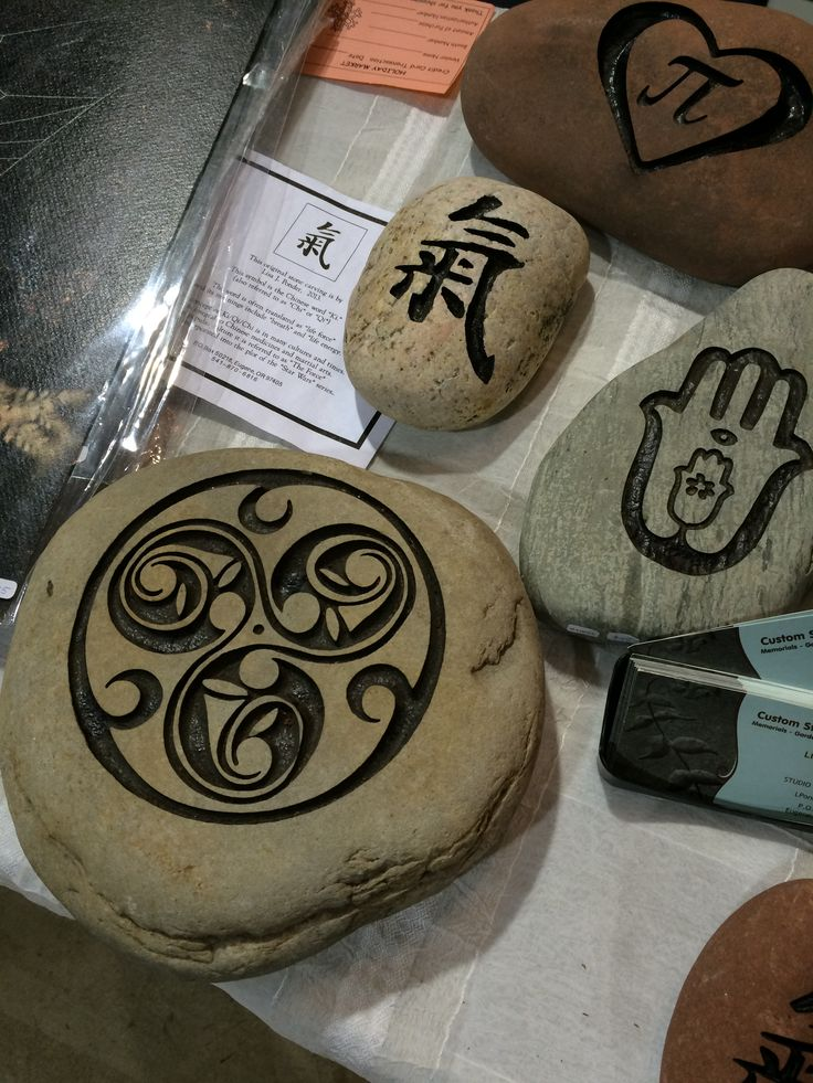 Custom carved stones by Lisa Ponder.