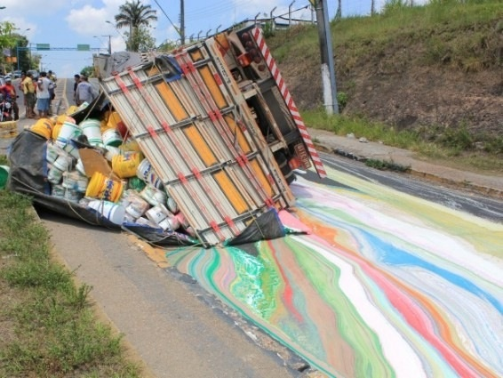 """A truck loaded with cans of paint tipped over in Central South Manaus, Brazil and created a """"rainbow"""" on the road. The driver was fine and a cleaning crew was sent to clean up the site.Brazil, Trucks, The Roads, Painting Tips, Colors, Rainbows, Street Art, Accidents Art, Streetart"""
